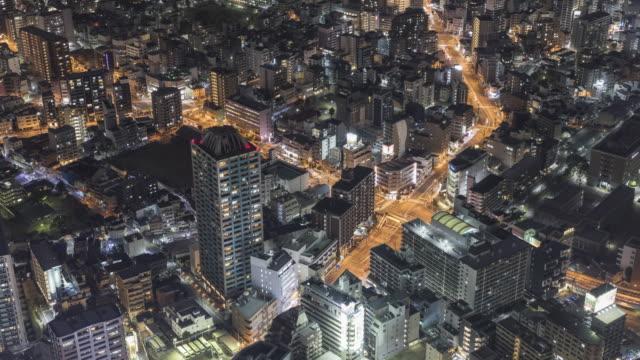 vídeos y material grabado en eventos de stock de modern high rise buildings in osaka at night, japan. - vida nocturna