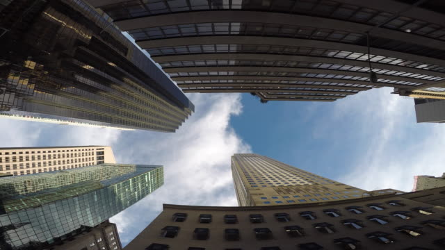 modern high rise skyscraper buildings in new york city. financial business district background - 真下からの眺め点の映像素材/bロール
