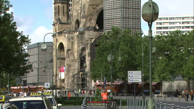 Modern high rises flank the Memorial Church in Berlin.