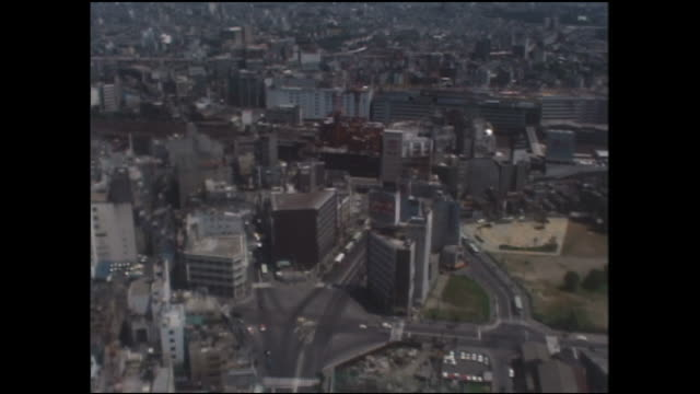 vidéos et rushes de modern high-rise office buildings tower over the city from west gate to east gate in postwar tokyo. - 1970