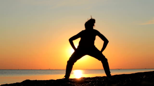 modern hip-hop dancer at sea sunset