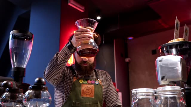 modern hipster barista working at a coffee shop preparing coffee - part time worker stock videos & royalty-free footage