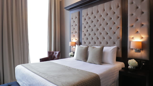 modern hotel bedroom interior - double bed stock videos & royalty-free footage