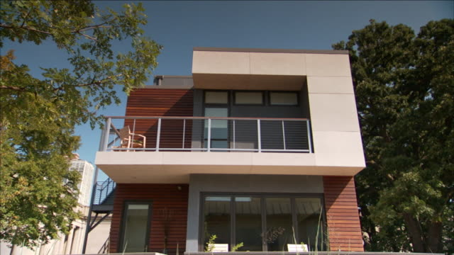a modern house features a second-floor balcony. - balcony stock videos & royalty-free footage