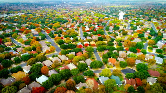 modern housing development as fall foliage changing colors and makes colorful landscape above suburb suburbia - modern rock stock videos & royalty-free footage