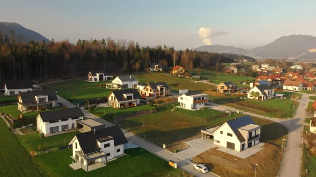 modern housing development in the country side - prato rasato video stock e b–roll