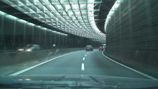 modern hypnotic road tunnel - car point of view stock videos & royalty-free footage