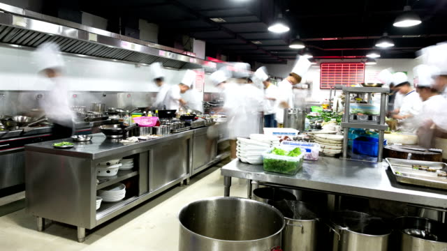 modern kitchen and busy chefs, time lapse. - chef's hat stock videos & royalty-free footage