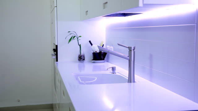 modern kitchen in ultraviolet light - household fixture stock videos and b-roll footage