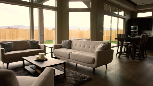 modern living room in a new house - studio camera video stock e b–roll