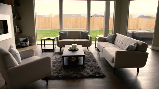 modern living room in a new house - furniture stock videos & royalty-free footage