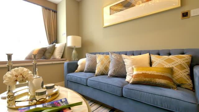 modern living room interior 4k - sofa stock videos & royalty-free footage
