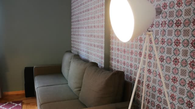 modern living room with couch and lamp - lampada elettrica video stock e b–roll
