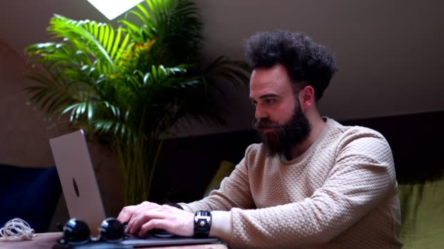modern looking hipster working on a laptop computer at a cafe - business casual stock videos & royalty-free footage