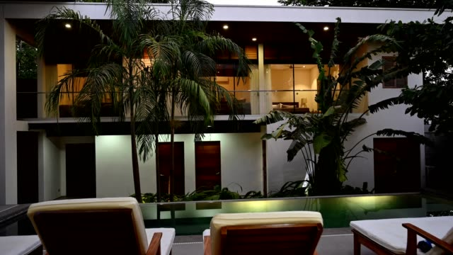 modern luxury home at dusk - real estate stock videos & royalty-free footage