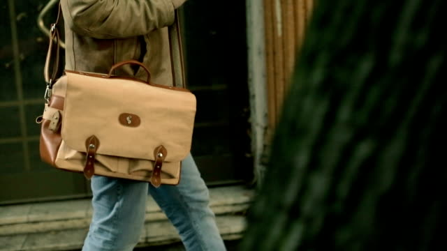 modern man with leather bag - bag stock videos & royalty-free footage
