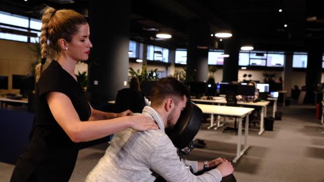vídeos de stock e filmes b-roll de modern management illness caused by a stressful work day, are so common this days - dor no pescoço