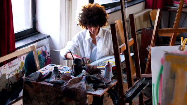 modern messy artist painting with hand - professional painter stock videos and b-roll footage