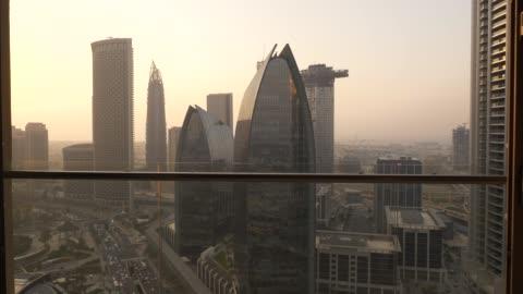 vídeos y material grabado en eventos de stock de modern metropolis with financial banking business buildings - global finance