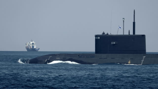 modern missile submarine on the protection of shipping - submarine stock videos and b-roll footage