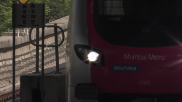A modern monorail train draws into a station Mumbai Maharashtra India FKAD675A Clip taken from programme rushes ABQA810K