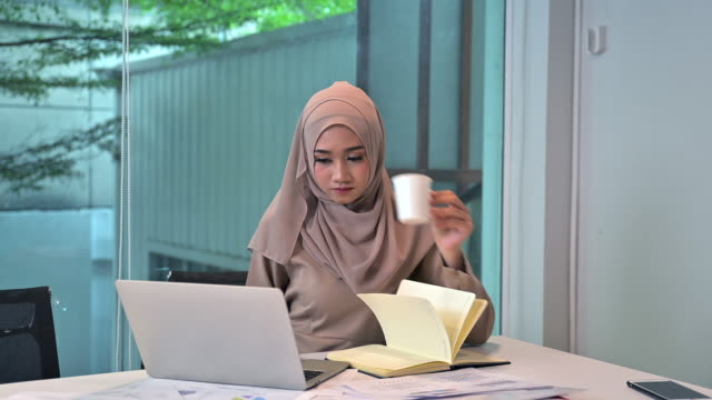 modern muslim business women working with laptop and document in modern style office - cheerful stock videos & royalty-free footage