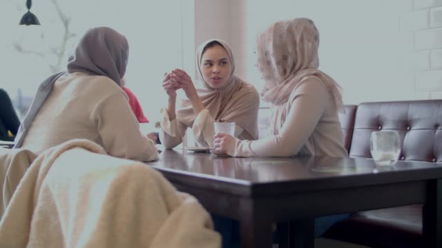 modern muslim girls in a cafe - hijab stock videos & royalty-free footage