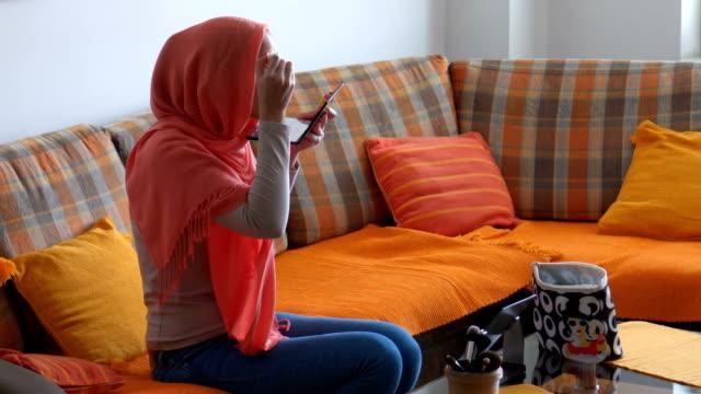 modern muslim woman applying make-up - modest clothing stock videos & royalty-free footage