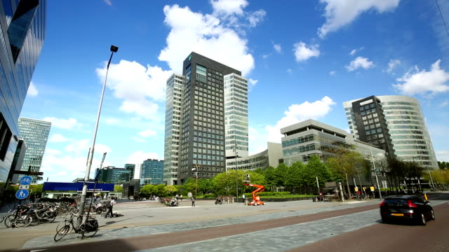modern office building in amsterdam, time lapse - bank financial building stock videos and b-roll footage