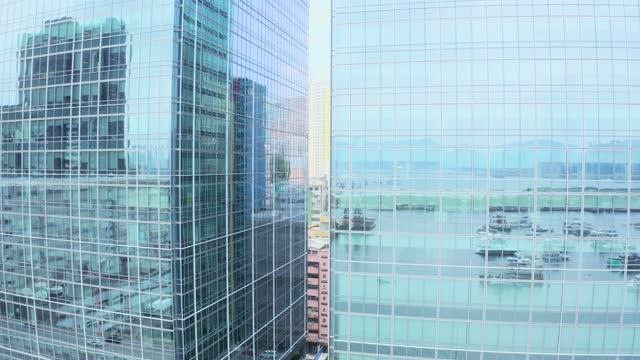 vídeos de stock, filmes e b-roll de edifício de escritórios moderno, kwun tong - torre estrutura construída