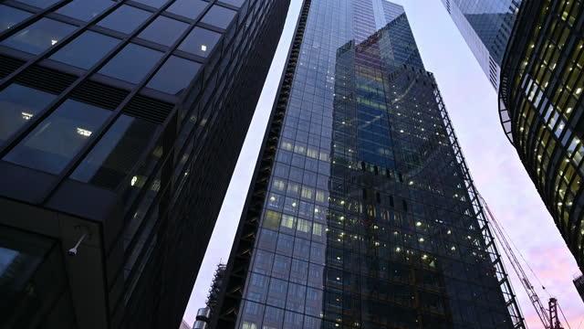 modern office buildings in london financial district - tilt down stock videos & royalty-free footage