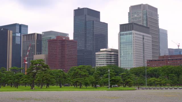 modern office buildings in marunouchi - marunouchi stock videos & royalty-free footage