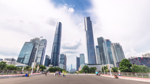 modern office buildings in midtown of guangzhou from road. timelapse