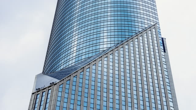 modern office buildings in shanghai. timelapse - wall building feature stock videos & royalty-free footage