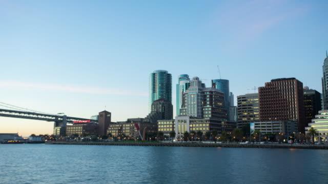 modern office buildings near bay bridge at sunrise. timelapse 4k