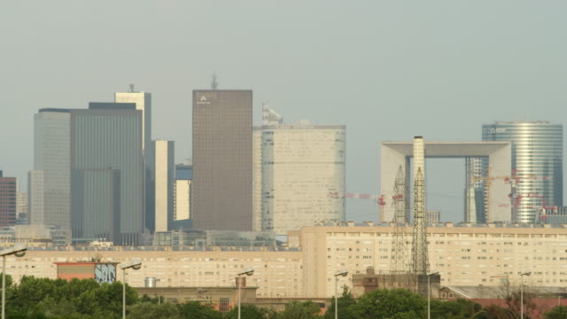 LS PAN modern office buildings of La Defense with the Grande Arche in center; PAN stops on Eiffel Tower