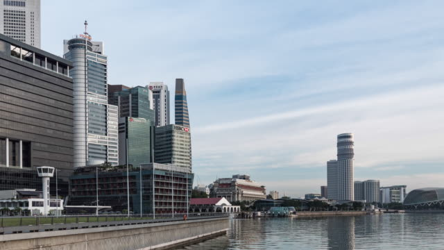 modern office buildings on marina bay with blue sky, singapore, time lapse video - directly below stock videos & royalty-free footage