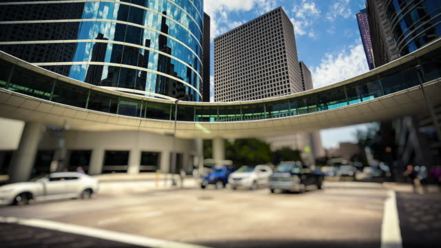 modern office buildings & traffic in downtown houston, texas - time lapse - elevated walkway stock videos & royalty-free footage