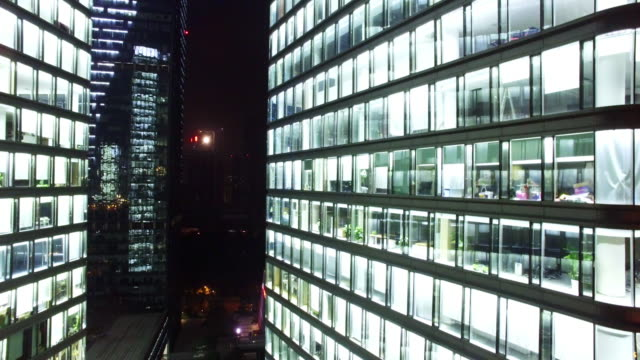 modern office buildings with glass wall in hangzhou at night 4k