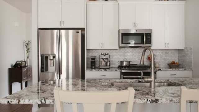 modern open concept home interior - kitchen stock videos & royalty-free footage