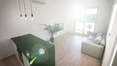 modern öppen planlösning kök vardagsrum design i en ny modern lägenhet - boningsrum bildbanksvideor och videomaterial från bakom kulisserna