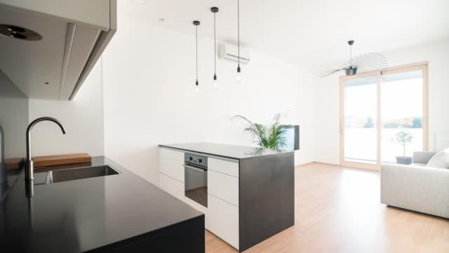 modern open plan kitchen living room design - pendant light stock videos & royalty-free footage
