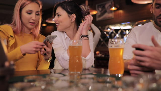 modern people in pub - bar area stock videos & royalty-free footage