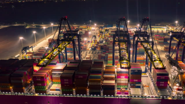 modern port container operation at night - bridge built structure stock videos & royalty-free footage