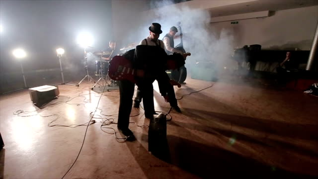 modern rock and roll band on great concert inspired by rockabilly style - punk music stock videos and b-roll footage