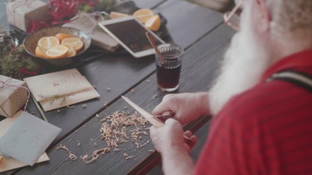 modern santa claus making toys (slow motion) - log fire stock videos & royalty-free footage