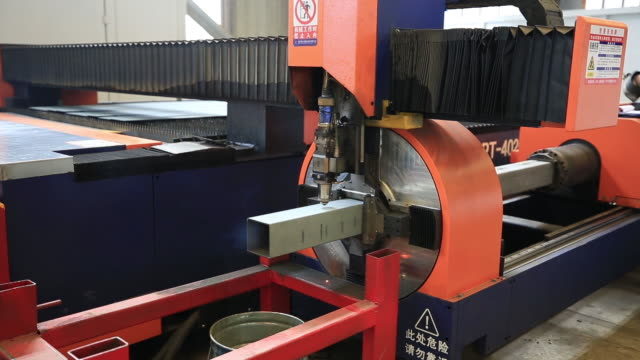 modern semi-automatic robotic welding machine in a metal factory manufacturing plant, xiamen, china - machine part stock videos & royalty-free footage