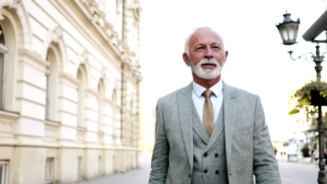 Modern senior businessman enjoying his walk in the city