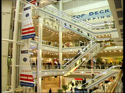 Modern shopping mall including escalators glass elevators and shoppers Kingston Upon Hull