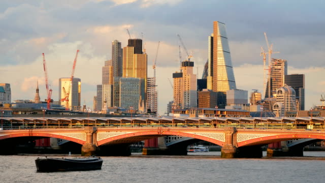 Modern skyscrapers and Thames river in London